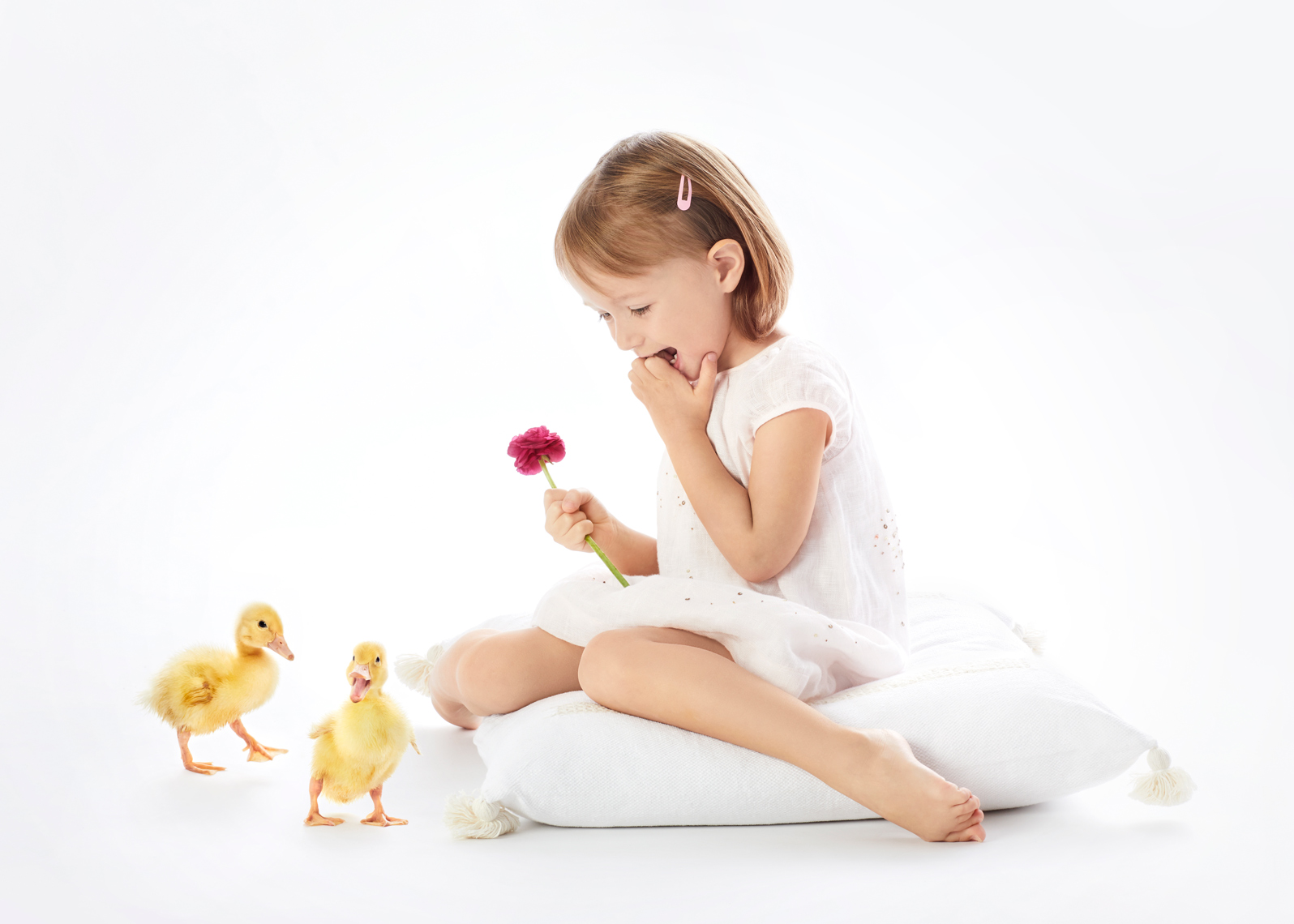 Girl with ducklings and flower