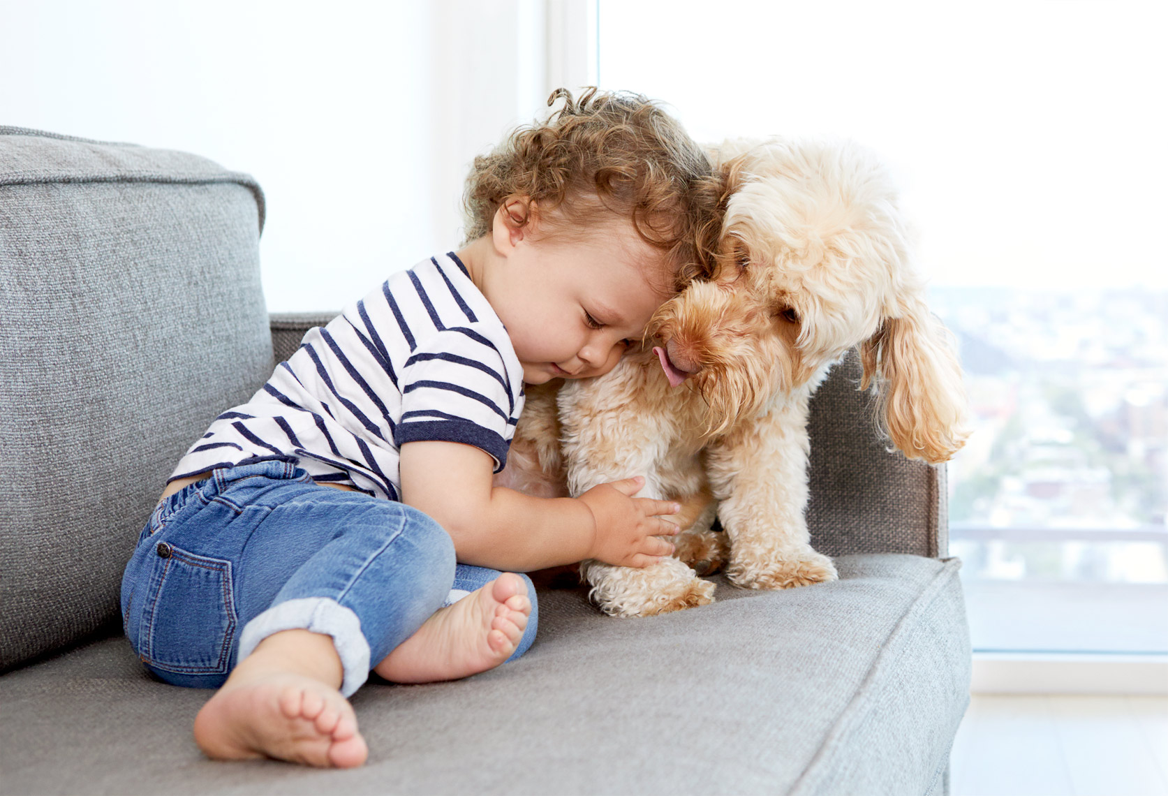 Toddler hugging dog