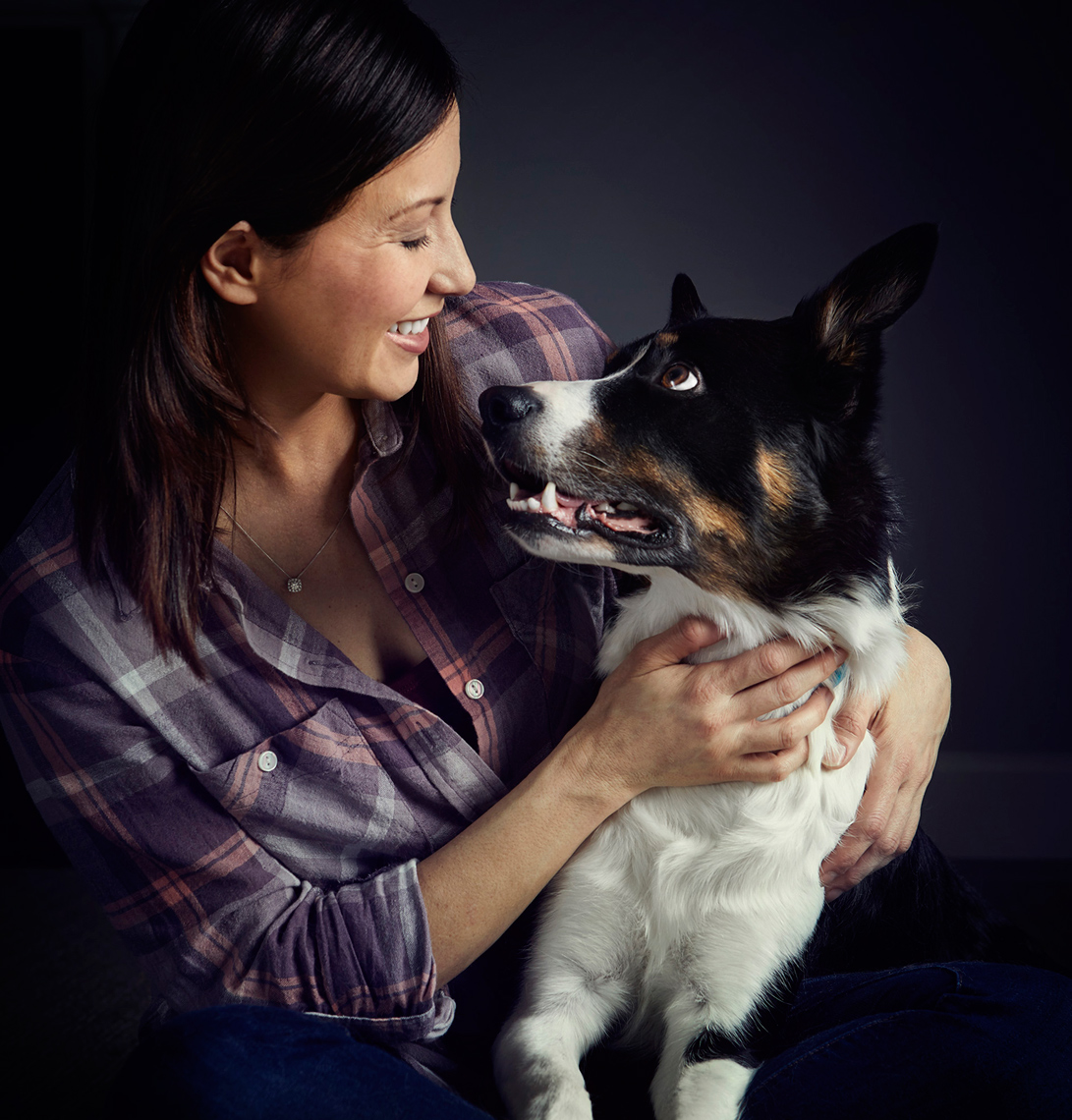 Woman embracing dog